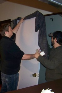 Jesse Low and Jeff Butler setting up the door