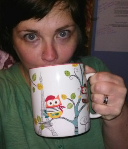 No make-up, messy hair, bad angle, giant coffee cup...